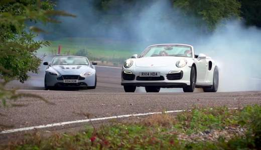 Vídeo: Porsche 911 Turbo S vs Aston Martin V12 Vantage S