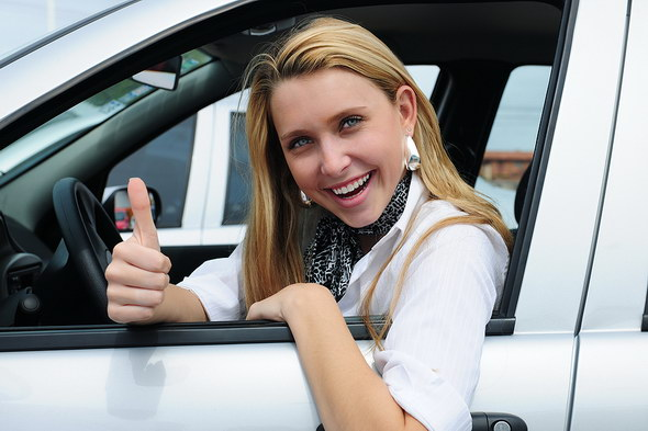 bigstock_Happy_Woman_Driving_A_New_Car_5981320